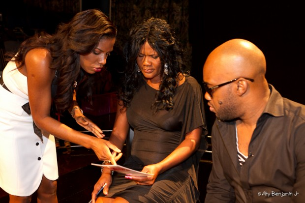 Host and executive director of Mission Catwalk Keneea Linton George gives Lady Saw some pointers while Carlton Brown looks on