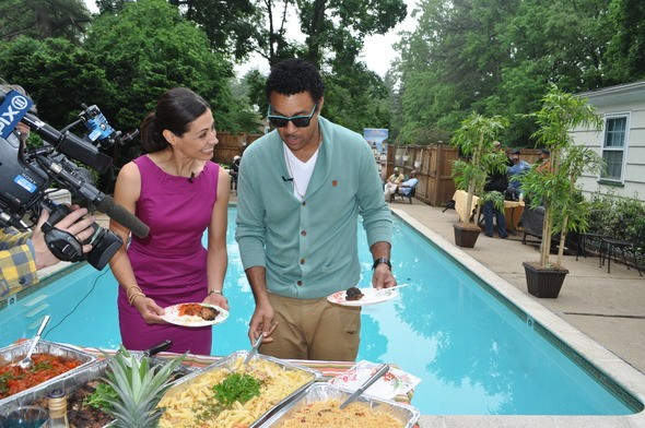 PIX 11 TV personality Lisa Mateo with reggae idol Shaggy checking out the cuisine at the Adidas Jamboree backyard brunch