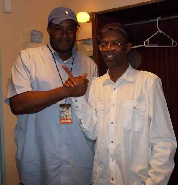 Christopher Roberts (l), of Groovin In The Park greets reggae crooner Beres Hammond. Beres will perform at Groovin In the Park on Sunday, July 1